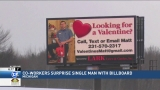 Co-workers surprise single man with billboard