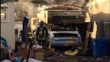 Cluttered RV catches fire off State Street